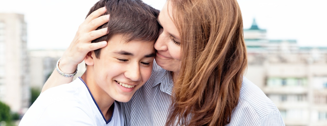 mother and son happy about online school