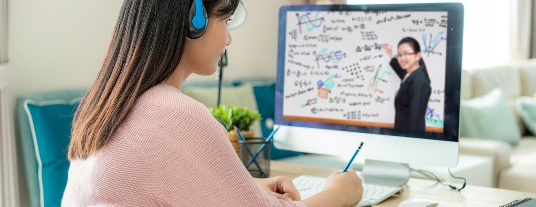 high school teen working on online school, studying online.