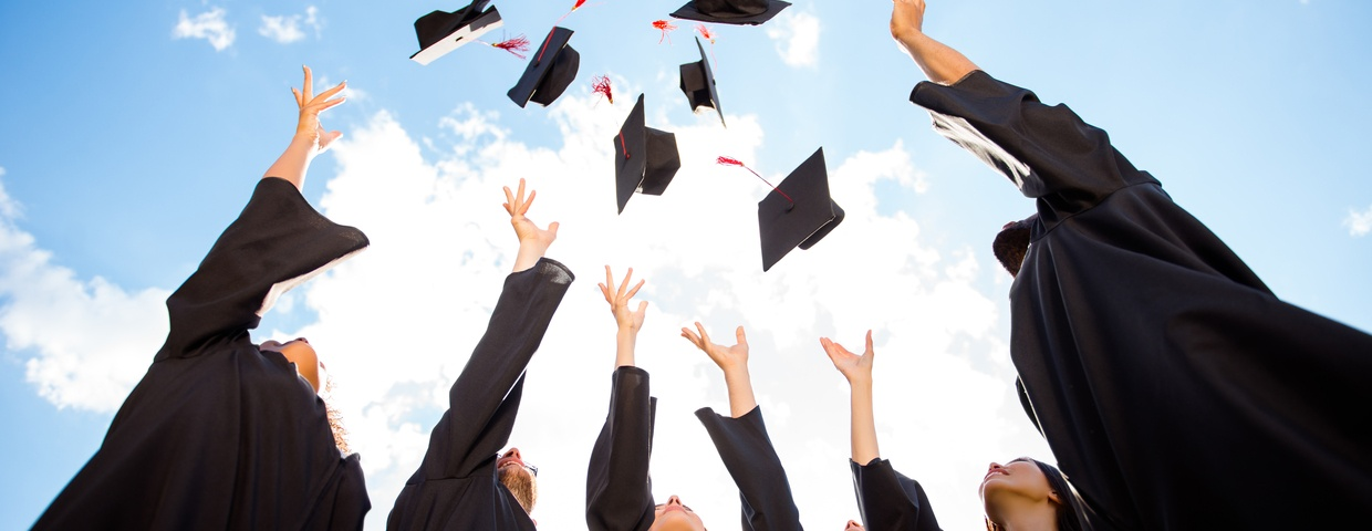 graduates throwing caps after graduating online high school early