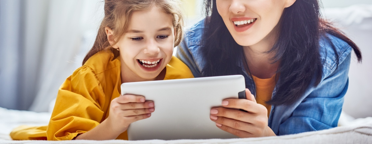 mother helping daughter with online class